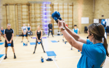 A group kettlebell workout at bluecoat sports
